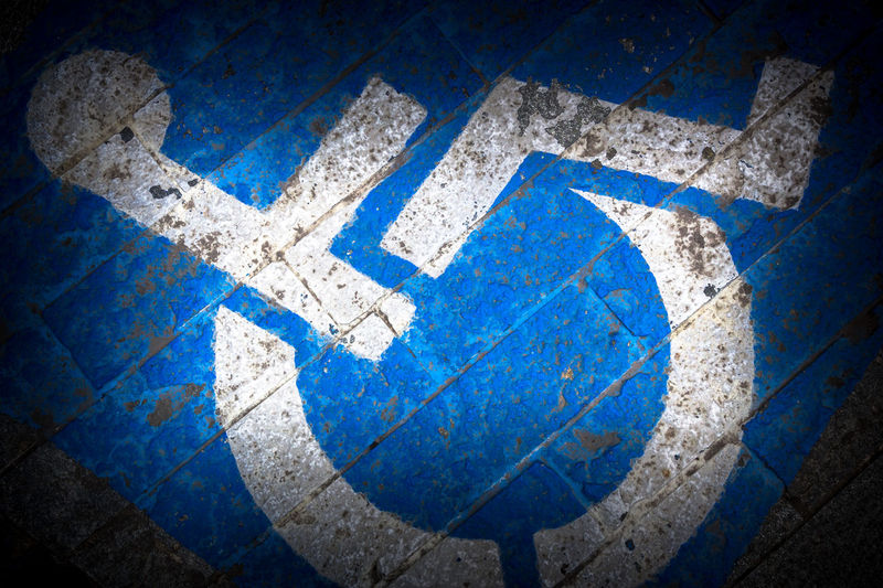 Grungy tone of sign disabled painted on the floor Access Asphalt Azure Background Blue Care Dark Disability  Disabled Grunge Handicap Handicapped Icon Invalid  Medical Paint Parking People Permit Reserved Road Shadows Sign Space Street