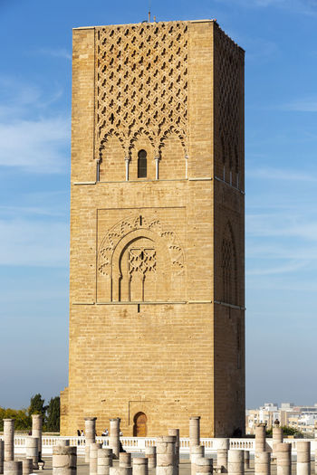 Hassan tower against blue sky