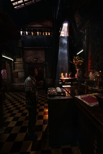 ... One Person Illuminated Pray Praying Prayer Prayertime Light And Shadow Light Up Your Life Light And Shadows Light In The Darkness Pagoda EyeEm Best Shots Eyeemphoto Streetphotography Streetphoto_color Captured Moment Capture The Moment People Person Indoors  One Man Only