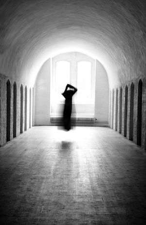Headless ghost floating above the floor in medieval nunnery. Absence Arch Architectural Column Architecture Asylum Blackandwhite Corridor Crazy Diminishing Perspective Floating Ghost Halloween Headless Horror Medieval Monochromatic Nunnery Scary Spooky The Way Forward Woman