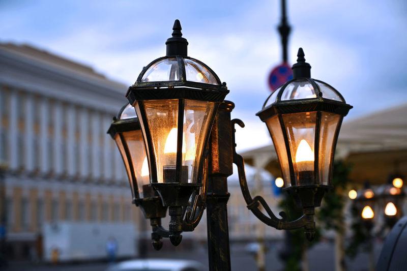 Close-up of illuminated street light against sky