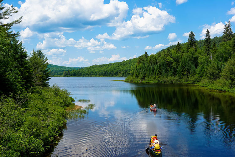 Beauty In Nature Blue Blue Sky Canada Cloud Cloud - Sky Clouds And Sky Green Color Growth Lake Leisure Activity Lifestyles National Park Nature Nature Non-urban Scene Quebec Reflection River Scenics Sky Tranquil Scene Tranquility Tree Water