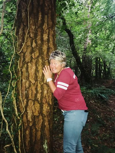 Happy to hug a tree In The Wild Happy Woodland Walks Woods Green Tree Hugger At One With Nature Real People One Person Casual Clothing Leisure Activity Lifestyles Tree Plant Females Nature Standing Trunk Tree Trunk Innocence Outdoors