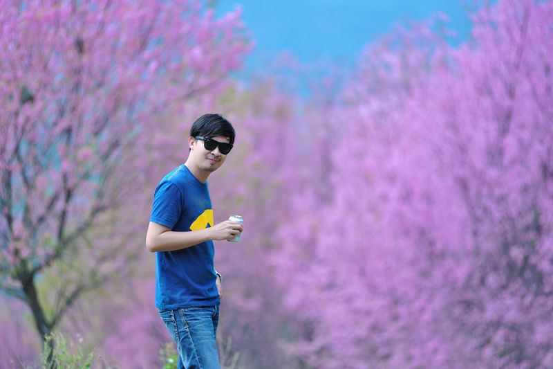 Asian Man Sakura Floral Park Pink Smart Boys Can Casual Clothing Childhood Day Leisure Activity Lifestyles Nature One Person Outdoors Park People Real People Standing Sunglasses Technology Wireless Technology Young Adult