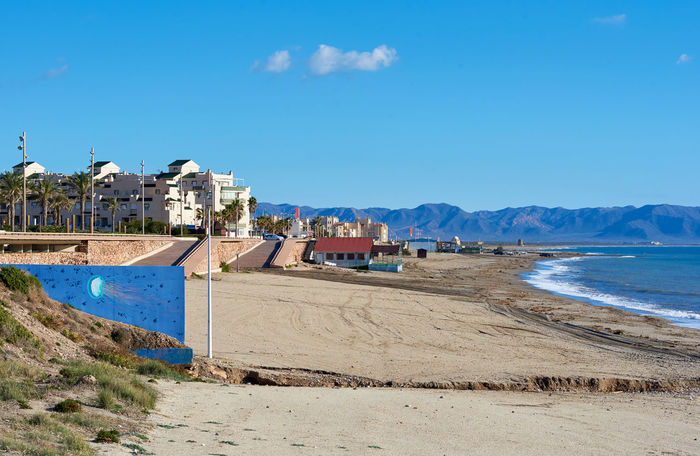 Coastline at Retamar. Province of Almeria. Spain Almería Andalucía Beach Beauty In Nature Coast Coastline Europe Houses Landscape Mediterranean Sea Nature No People Outdoors Retamar Sand Sea Sky SPAIN Sunlight Sunny Day Tourist Resort TOWNSCAPE Travel Destinations Tropical Climate Water