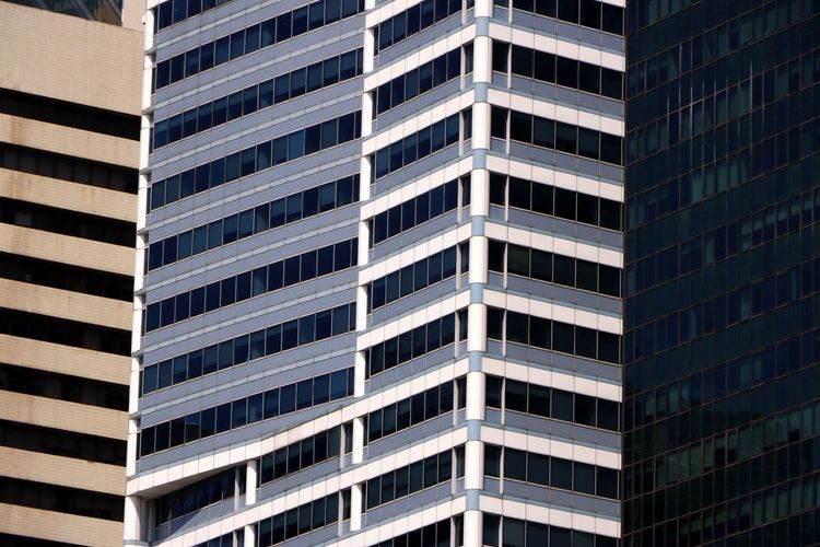 The glass frontage of multiple office blocks in Singapore create a natural abstract pattern Business Travel Travel Photography Abstract Apartment Architecture Building Building Exterior Built Structure City Day Full Frame High Rise Building Low Angle View Modern No People Office Office Building Exterior Outdoors Pattern Skyscraper Tall - High Tower Travel Destination Window