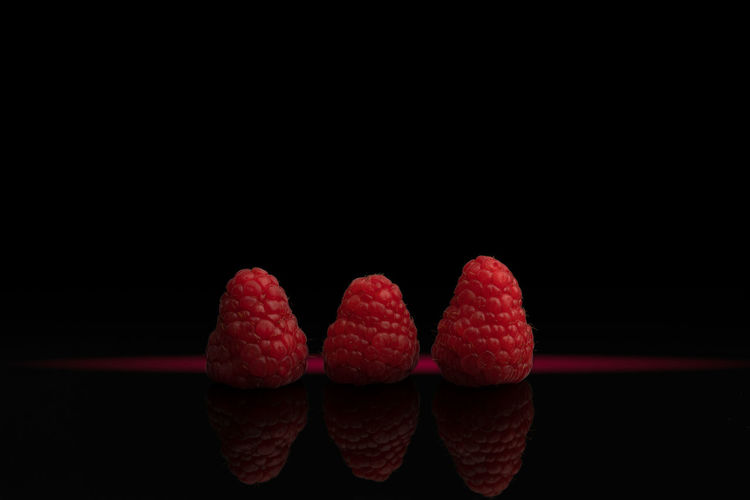 Close-up of strawberry over black background