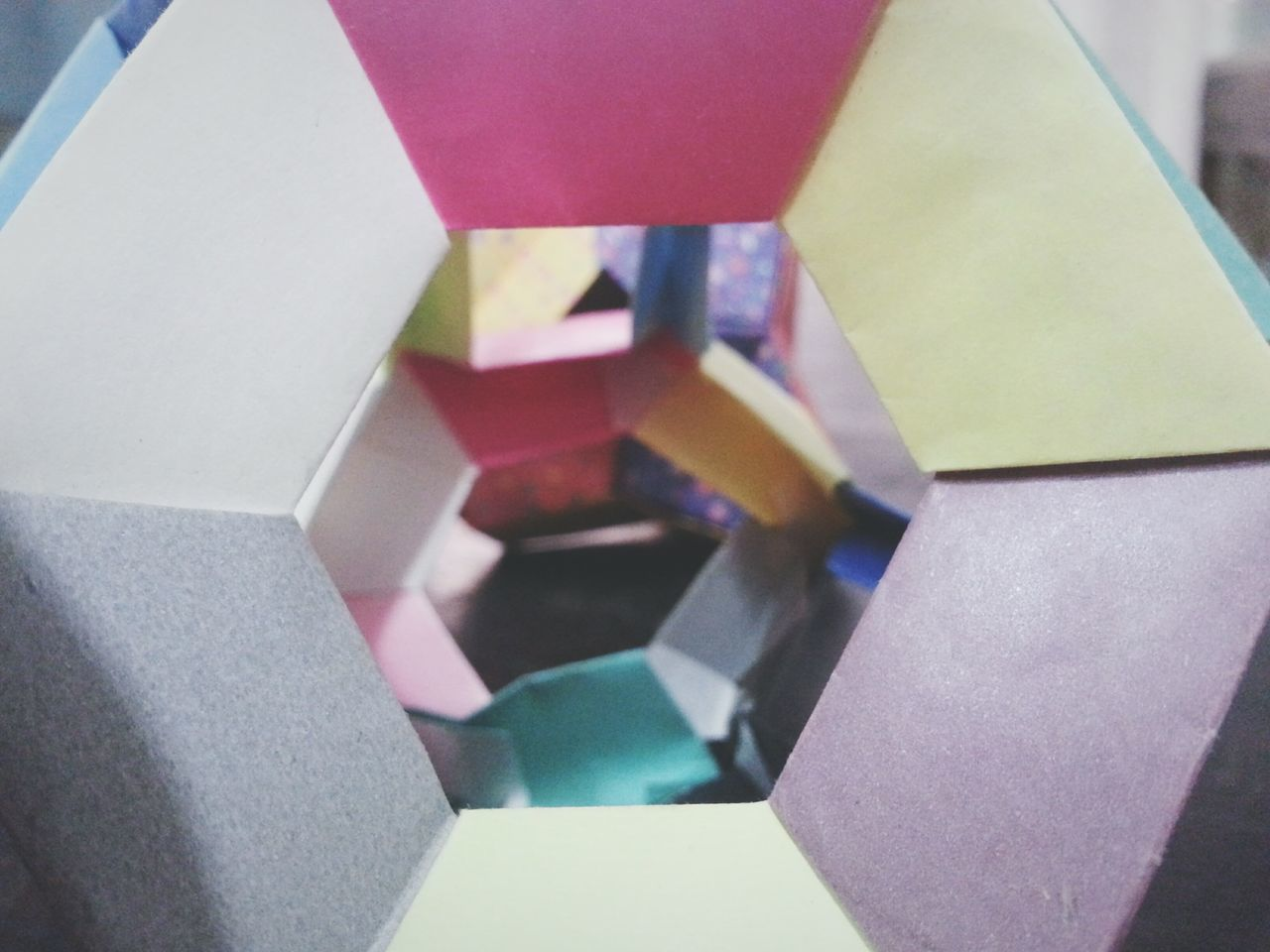multi colored, indoors, close-up, high angle view, no people, paper, stack, day, geometry