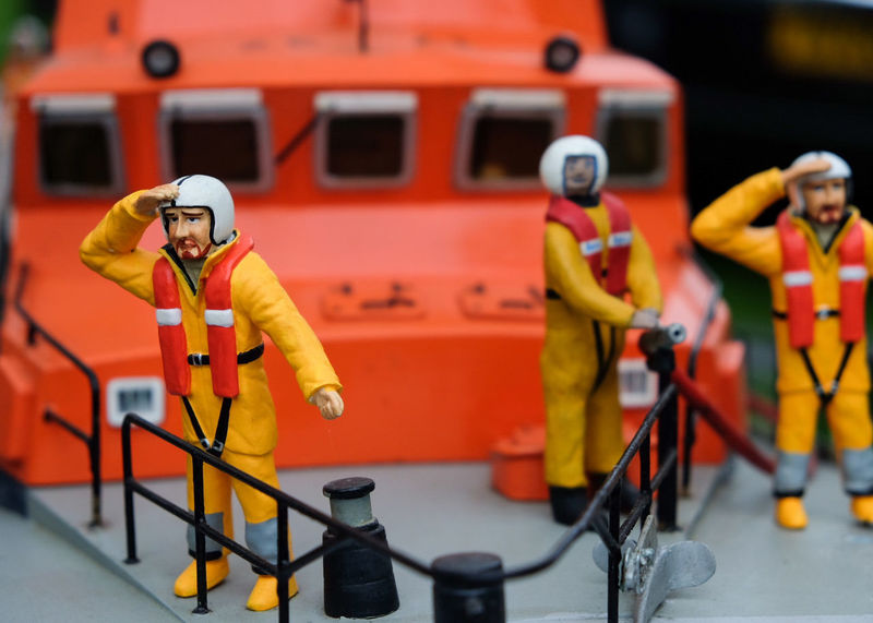 Group Of People Full Length Adults Only Red Uniform Men Reflective Clothing Headwear Occupation Outdoors Young Adult Day Hardhat  Lifeboat RNLI Lifeboat Paramedic RNLI Model Toy