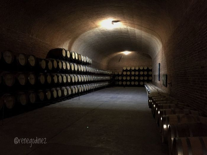 Cava Wine Cellar Indoors  Wine Cellar Alcohol In A Row Arch Illuminated Winemaking Wood - Material No People Tunnel Wine Rack Architecture