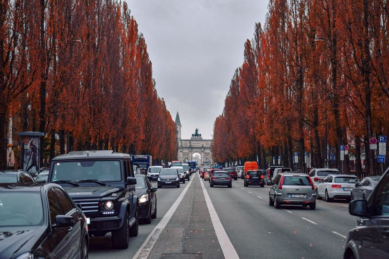The pictures are there, and you just take them. Fall Colors Fall Urban Car Motor Vehicle Mode Of Transportation Transportation Land Vehicle City Road Architecture Street City Street Sky City Life Travel Traffic First Eyeem Photo