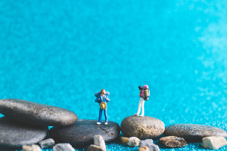 Background Backpack Backpacker Closeup Concept Enjoy Figure Human Little Macro Mini Miniature Model People person Small Tiny Tourist Toy Travel Traveler Trip Vacation