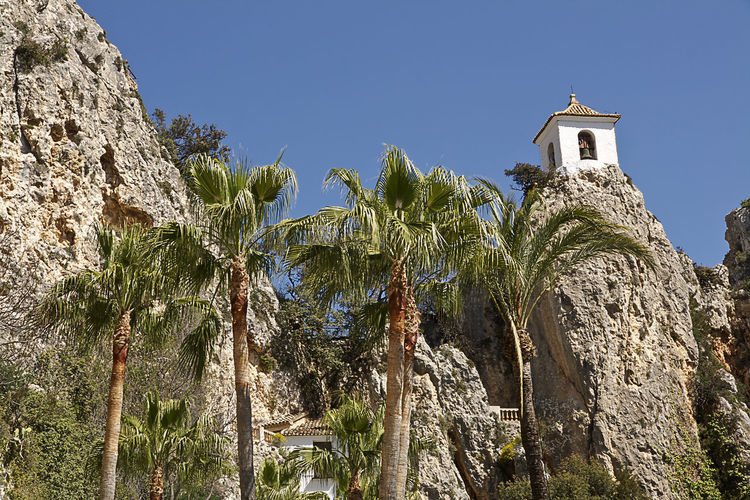 Castle of Guadalest in the province of Alicante, Spain Alacant Alicante Castle Castle Of Guadalest Guadalest Guadalest Spain Spanish Travel Valencia Community Architecture Beauty In Nature Bell Tower Building Exterior Built Structure History Low Angle View Mountain Nature No People Outdoors Rock - Object Sky Spaın Travel Destinations Tree