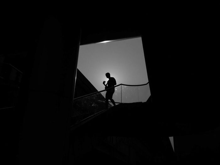 Silhouette man on staircase