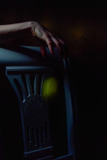 Close-up of woman hand holding illuminated lamp