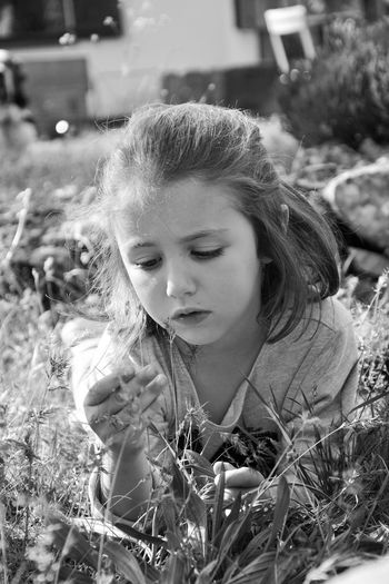 Childhood Girls One Person Real People Elementary Age Leisure Activity Casual Clothing Outdoors Day Grass Nature Close-up People Focus On Foreground Nature Lovemychild Innocence Rêve Blackandwhite Photography Black & White Blavk And White Shoot