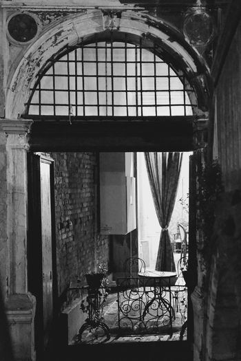 Black & White Getty X EyeEm Absence Arch Architecture Balcony Black And White Building Built Structure Chair Day Getting Inspired History House Indoors  Metal No People Old Ornate Railing Seat Wall Window Windows Wrought Iron