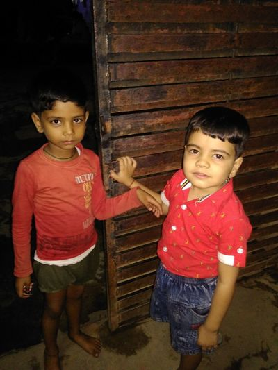 Indian happy child Vertical Child Boys Two People Males  Childhood Dark People Night