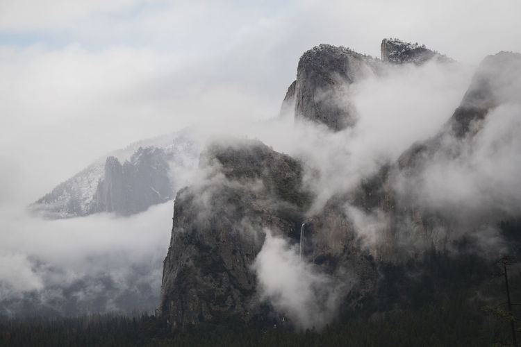 Mountains in Yosemite blanketed in fog. Beauty In Nature Scenics - Nature Mountain Non-urban Scene Tranquil Scene Fog No People Cloud - Sky Nature Environment Mountain Range Landscape Outdoors Mountain Peak Yosemite National Park