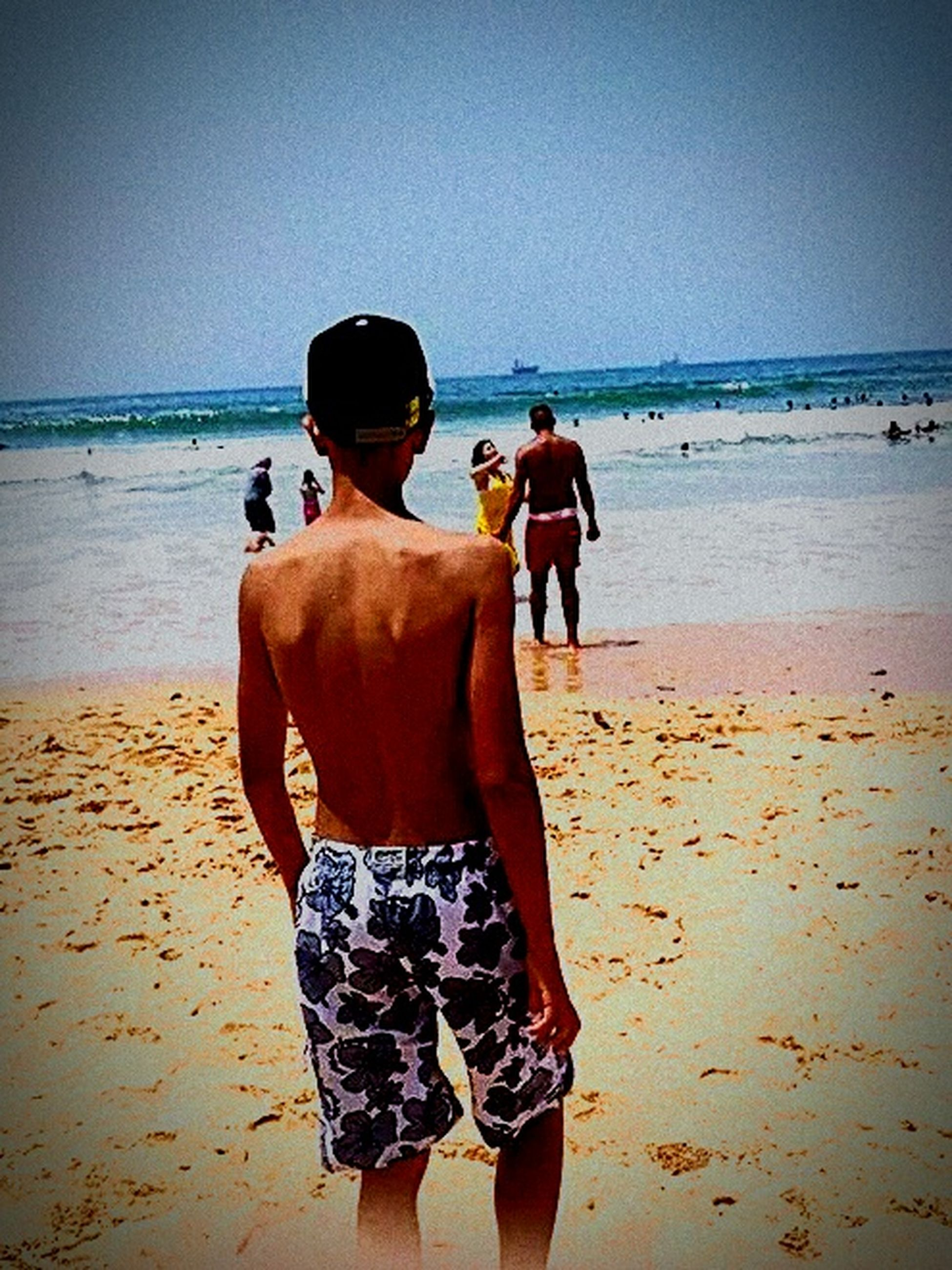 beach, sea, horizon over water, sand, water, shore, clear sky, lifestyles, leisure activity, togetherness, rear view, men, vacations, person, full length, standing, bonding, copy space