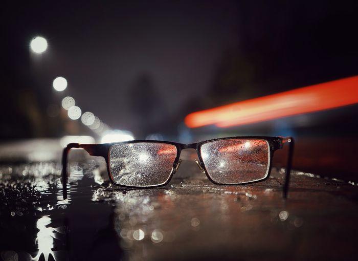 Close-up of eyeglasses on illuminated table