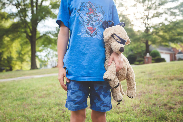 Blue Casual Clothing Focus On Foreground Friendship Holding Leisure Activity Outdoors Person Standing Stuffed Animals