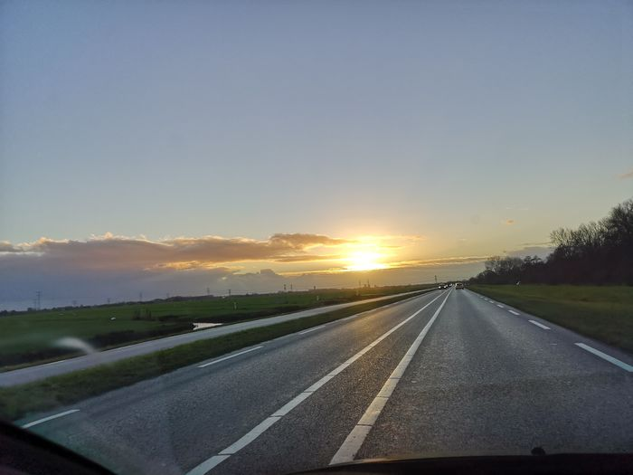 Road to nowhere..... Sunset Road Business Finance And Industry Journey Car City Highway Diminishing Perspective Sky Travel