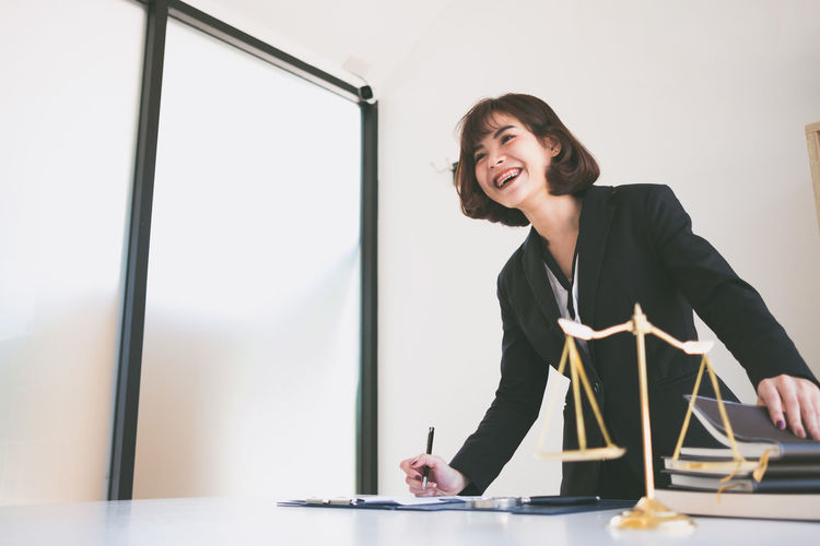 Smiling lawyer working at office