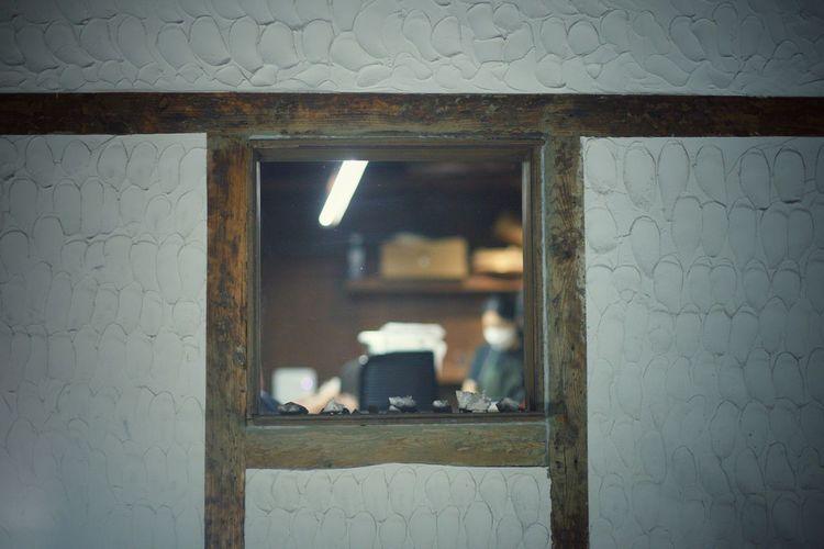 Reflection of illuminated window on wall