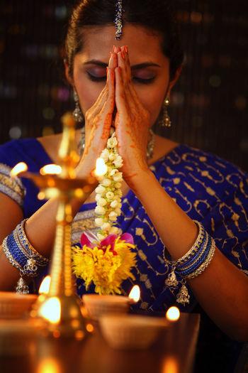 Beautiful Indian Woman In Sari Praying During Diwali