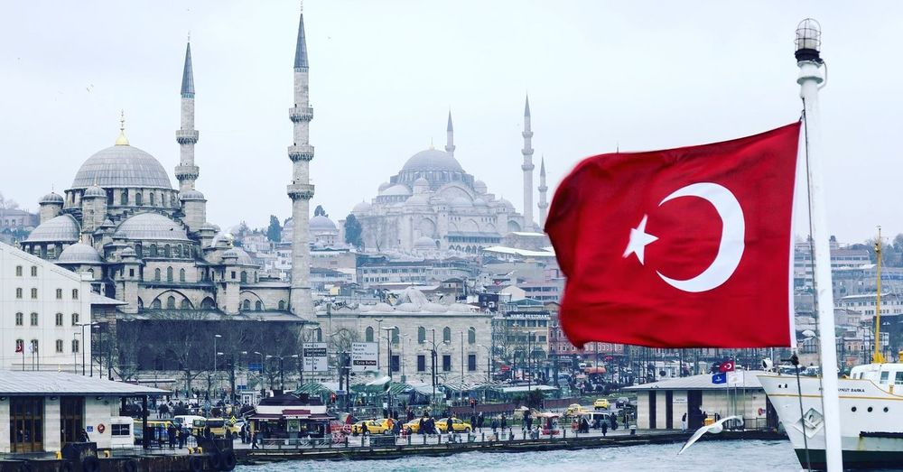 Turkish Flag And Blue Mosque Against Sky In City