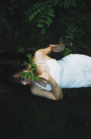 EyeEmNewHere The Week on EyeEm Plant Real People Nature High Angle View One Person Lifestyles Women Casual Clothing Leisure Activity Growth Green Color Day Land Field Outdoors Lying Down Plant Part Leaf Relaxation Girl People Of EyeEm People Photography Human Body Part