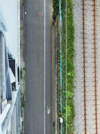 Directly above shot of road amidst building and railroad track