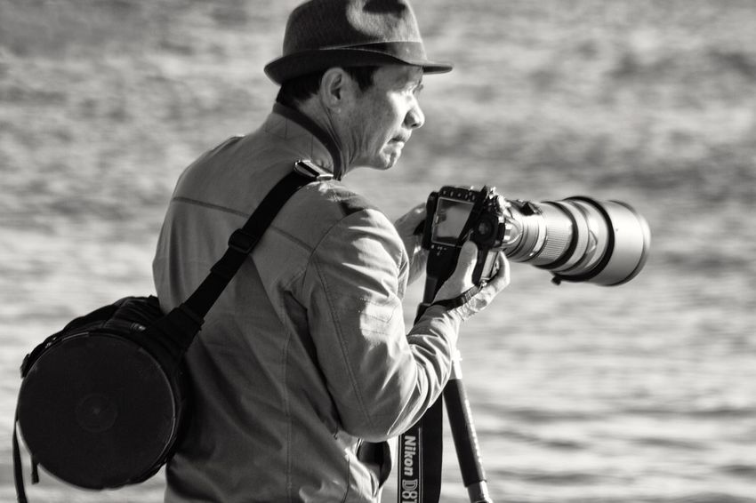 One Man Only Outdoors Photographer Adult Brooklyn Ny Coney Island / Brooklyn NY Black And White Photography Blackandwhite Photography Black And White One Person Beach Photography Man Tripod Zoom Lens