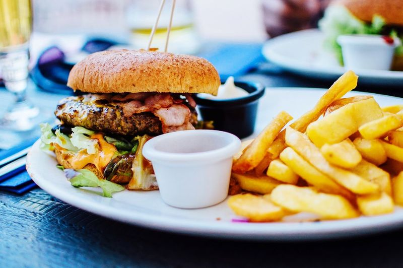 Close-up of french fries and burger in plate