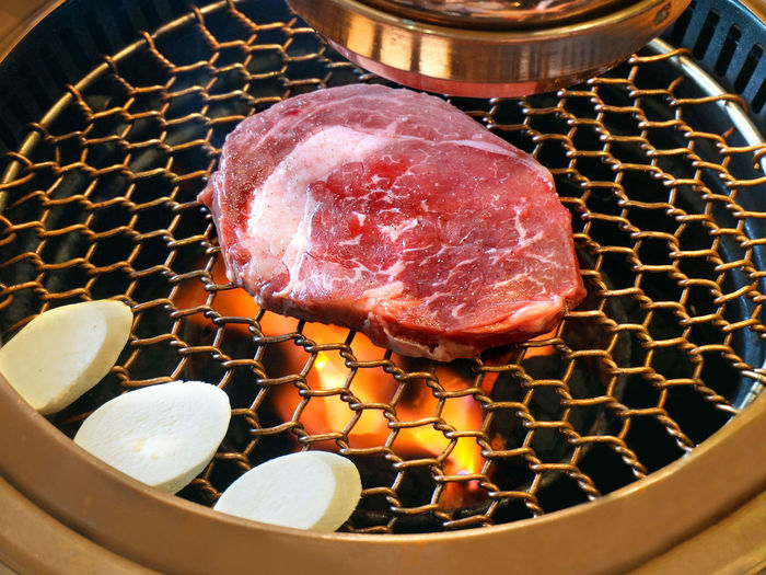 Grilling premium USDA beef at a Korean restaurant in Bonifacio Global City Barbecue Beef Dinner Fire Food Food And Drink Food Photography Food Porn Freshness Grill Grilled Grilling Indoors  Korea Meat Metal Grate No People Red Meat Steak