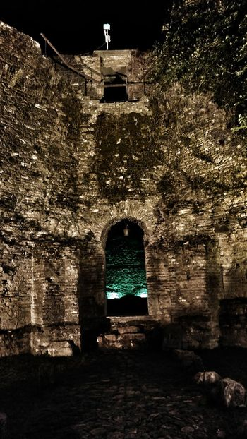 Kalaja, in Elbasan, Albania . Architecture Built Structure Arch Building Exterior Window Old Dark Outdoors Arched Day Entryway Narrow No People Bridge Long Exterior Leading Weathered Taking Photos Check This Out EyeEm Best Shots Eye4photography  Albania Elbasan Castle