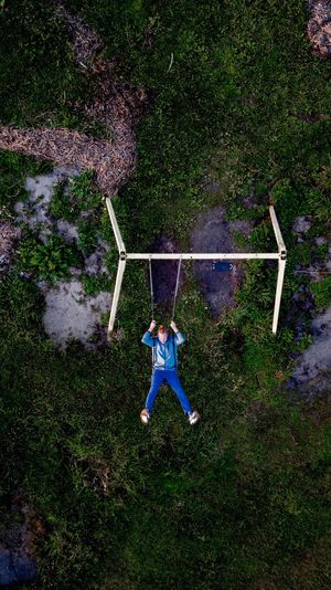 Directly above shot of man on swing at park