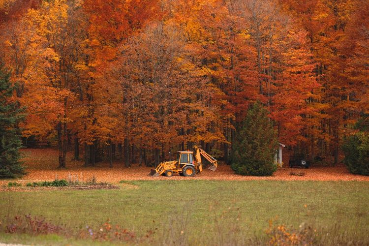 Mid Distance Of Excavator On Field During Autumn