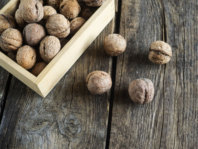walnuts in a wooden box on an old weathered wooden table Box Weathered Wood Background Close-up Day Directly Above Directly Abowe Food Food And Drink Freshness Healthy Eating High Angel View High Angle View Indoors  No People Old Studio Shot Table Walnuts Wood - Material Wooden