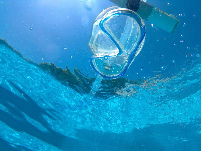 Close-up of scuba mask in sea
