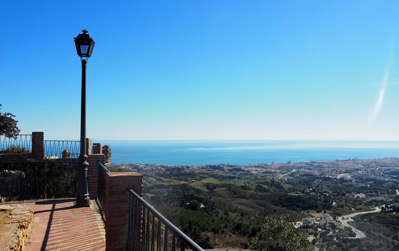Sky Architecture Street City Street Light Nature Lighting Equipment Built Structure Day Railing Clear Sky Blue Building Exterior No People Horizon Water Plant Landscape High Angle View Cityscape Outdoors Horizon Over Water Mijas Pueblo Mijas SPAIN