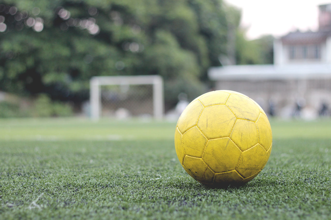 Close-Up Of Yellow Soccer Ball On Playing Field