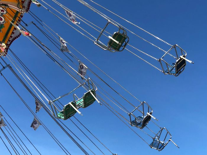 Nobody is having fun Sunlight Blue Sky Chains Flying Empty Chairs EyeEm Selects Low Angle View Sky Nature Blue Clear Sky Arts Culture And Entertainment Amusement Park Ride Chain Swing Ride Outdoors Hanging Enjoyment Metal No People Leisure Activity Day Amusement Park Spinning