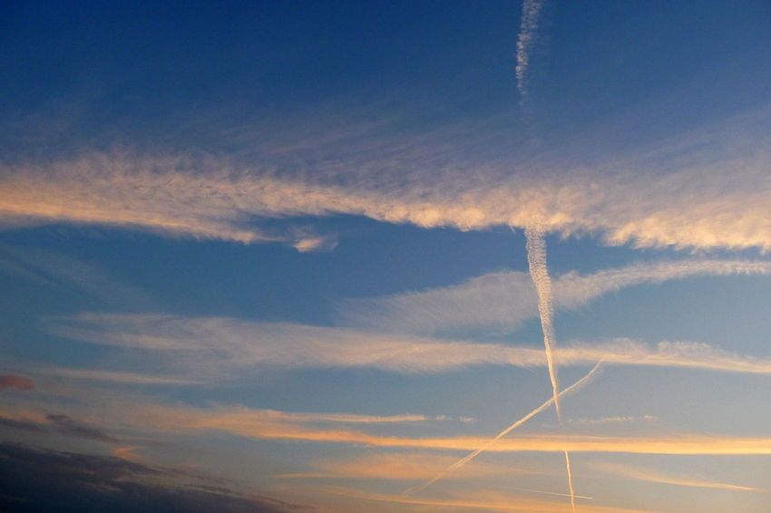 Cross In The Sky Dramatic Sky Beauty In Nature Blue Cloud - Sky Contrail Day Evening Sky Low Angle View Nature No People Outdoors Scenics Sky Sunlit Clouds Sunset Vapor Trail