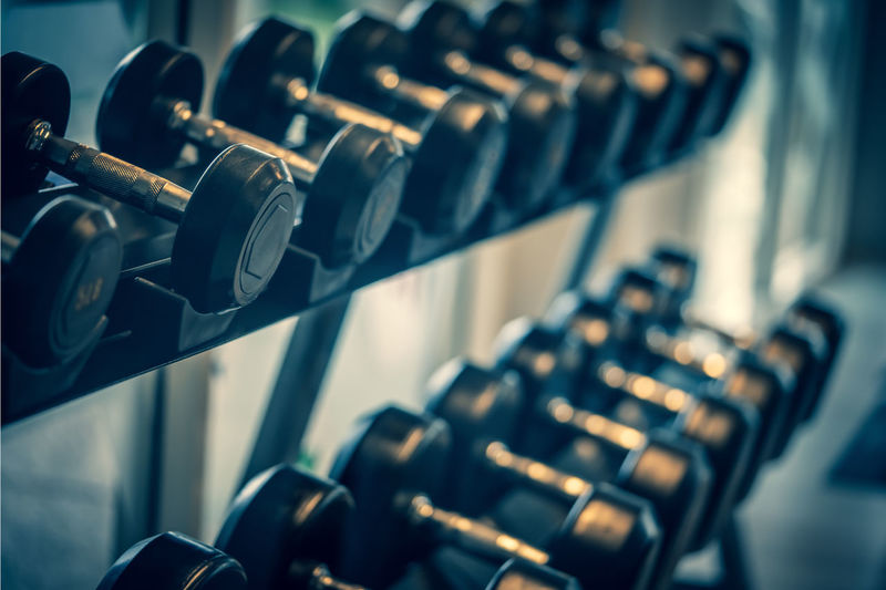 Close-up of dumbbells on rack