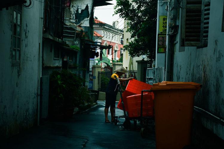 Man walking on street amidst buildings