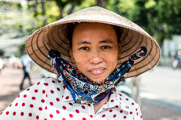 Streets of Hanoï | Vietnam Adult Day Focus On Foreground Hanoi Happiness Looking At Camera One Person One Woman Only Only Women People Portrait Real People Smiling Streetphotography The Photojournalist - 2017 EyeEm Awards Vietnam