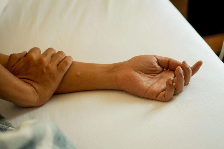 High angle view of woman massaging customer at spa