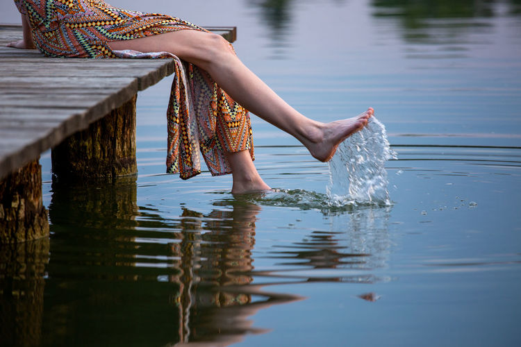 Low section of woman in lake